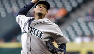 Seattle Mariners' Felix Hernandez delivers a pitch against the Houston Astros in the first inning of a baseball game on Friday, May 2, 2014, in Houston. (AP Photo/Pat Sullivan)