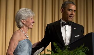 President Barack Obama, right, has outgoing Health and Human Services Secretary Kathleen Sebelius come on stage as part of a joke to fix a technical glitch at the end of his speech during the White House Correspondents' Association (WHCA) Dinner at the Washington Hilton Hotel, Saturday, May 3, 2014, in Washington. (AP Photo/Jacquelyn Martin)