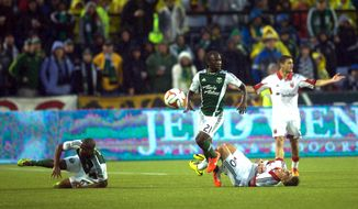 A foul is called on the Portland Timbers Saturday, May 3, 2014 in Portland as they host DC United. (AP Photo/The Oregonian, Jamie Francis