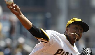 Pittsburgh Pirates starting pitcher Edinson Volquez throws against the Toronto Blue Jays in the first inning of a baseball game on Sunday, May 4, 2014, in Pittsburgh. (AP Photo/Keith Srakocic)