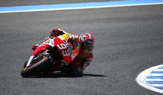 MotoGP raider Marc Marquez of Spain steers his Honda during the Spain's Motorcycle Grand Prix at the Jerez race track on Sunday, May 4, 2014 in Jerez de la Frontera, southern Spain. (AP Photo/Miguel Angel Morenatti)