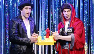 "This image released by Glenna Freedman Public Relations shows Scott Richard Foster, left, and Marcus Stevens parodying the musical ""Rocky: The Musical"" in Gerard Alessandrini's ""Forbidden Broadway Comes Out Swinging."" (AP Photo/ Glenna Freedman Public Relations, Carol Rosegg)"