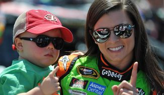 Danica Patrick holds Kevin Harvick's son Keelan before the NASCAR Aaron's 499 Sprint Cup series auto race at Talladega Superspeedway, Sunday, May 4, 2014, in Talladega, Ala. (AP Photo/Rainier Ehrhardt)
