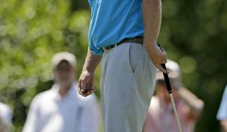 J.B. Holmes watches his putt on the fourth hole during the final round of the Wells Fargo Championship golf tournament in Charlotte, N.C., Sunday, May 4, 2014. (AP Photo/Chuck Burton)
