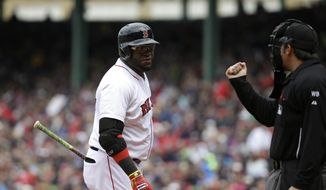 Boston Red Sox's David Ortiz, left, looks toward home plate umpire umpire Mark Ripperger, right, as he strikes out in the first inning of a baseball game against the Oakland Athletics, Sunday, May 4, 2014, in Boston. (AP Photo/Steven Senne)