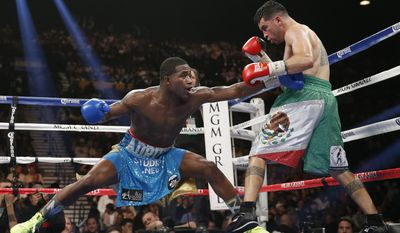 Adrien Broner, left, from Cincinnati, Ohio, throws a left to the body of Carlos Molina, from Norwalk, Calif., in their WBA super lightweight title boxing fight Saturday, May 3, 2014, in Las Vegas. (AP Photo/Eric Jamison)