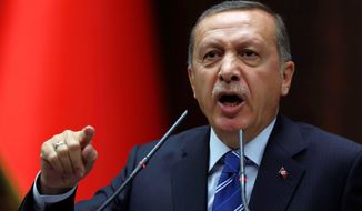 "Prime Minister Recep Tayyip Erdogan ordered Twitter and YouTube blocked and even threatened to ""eradicate Twitter"" to show the international community ""the power of the Turkish republic."" (Associated Press)"