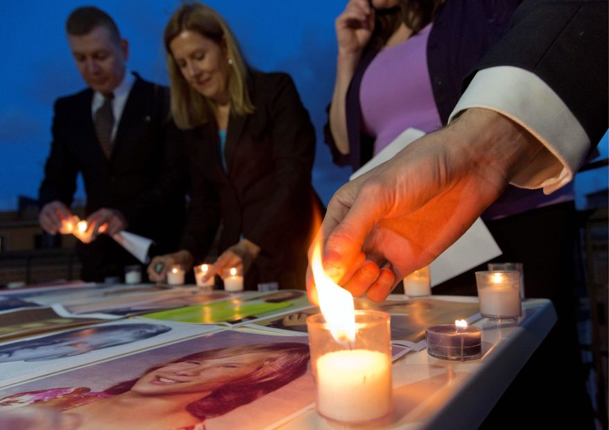 Members of Survivors Network of those Abused by Priests (from left) David D'Bonnabel from Austria, President Barbara Blaine from the U.S., Nicky Davis from Australia and Miguel Hurtado from Spain light candles during a protest to denounce abuses in Rome two days before the canonizations of Popes John XXIII and John Paul II. (AP Photo)