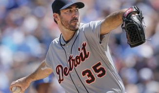 Detroit Tigers starting pitcher Justin Verlander delivers to a Kansas City Royals batter during the first inning of a baseball game in Kansas City, Mo., Sunday, May 4, 2014. (AP Photo/Orlin Wagner)