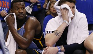 Memphis Grizzlies guard Tony Allen, left, and forward Mike Miller, right, look on from the bench late in the fourth quarter of Game 7 of an opening-round NBA basketball playoff series against the Oklahoma City Thunder in Oklahoma City, Saturday, May 3, 2014. Oklahoma City won 120-109. (AP Photo/Sue Ogrocki)