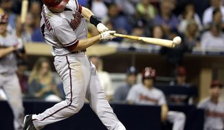 Arizona Diamondbacks first baseman Paul Goldschmidt hits a single against the San Diego Padres during the eighth inning of a baseball game, Saturday, May 3, 2014, in San Diego. (AP Photo/Gregory Bull)