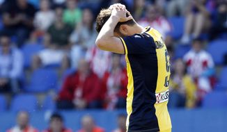 Atletico de Madrid's David Villa reacts during a Spanish La Liga soccer match against Levante at the Ciutat de Valencia stadium in Valencia, Spain, on Sunday, May 4, 2014. (AP Photo/Alberto Saiz)