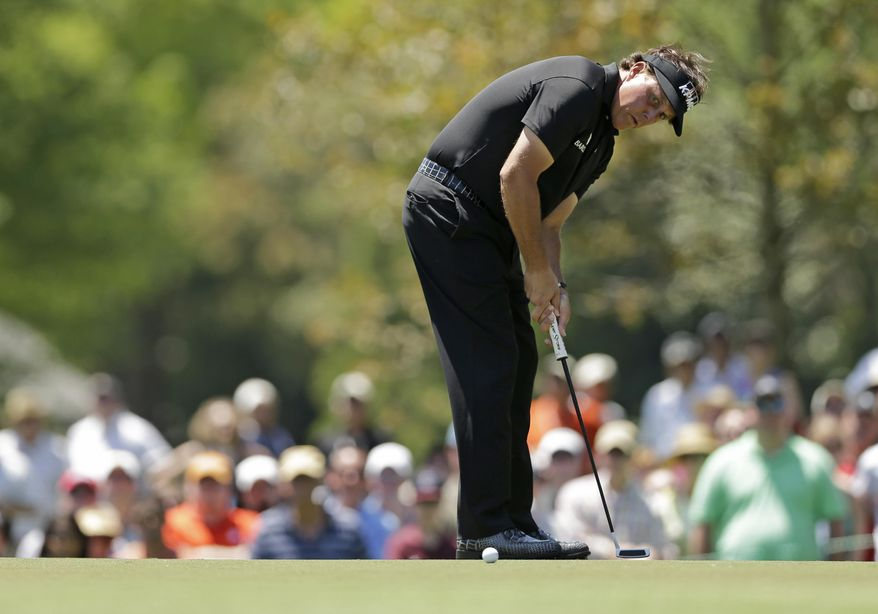 Phil Mickelson watches his putt on the second hole during the final round of the Wells Fargo Championship golf tournament in Charlotte, N.C., Sunday, May 4, 2014. (AP Photo/Chuck Burton)
