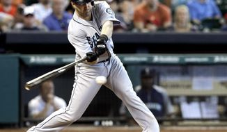 Seattle Mariners' Willie Bloomquist hits a two-run double against the Houston Astros in the third inning of a baseball game on Sunday, May 4, 2014, in Houston. (AP Photo/Pat Sullivan)