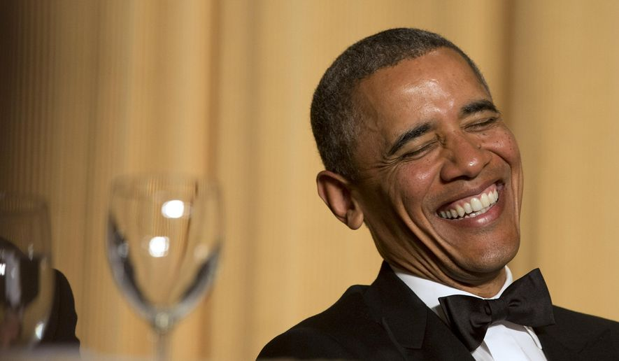 President Barack Obama laughs as actor and comedian Joel McHale speaks during the White House Correspondents' Association (WHCA) Dinner at the Washington Hilton Hotel, Saturday, May 3, 2014, in Washington. (AP Photo/Jacquelyn Martin)