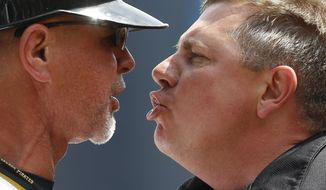Home plate umpire Greg Gibson, right, argues with Pittsburgh Pirates first base coach Rick Sofield after a third strike call to end the fourth inning of a baseball game against the Toronto Blue Jays, Sunday, May 4, 2014, in Pittsburgh. Sofield was ejected. (AP Photo/Keith Srakocic)