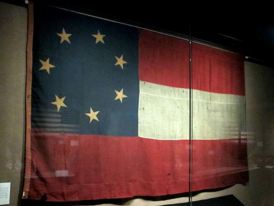 A rare seven-star Stars and Bars, the first flag of the Confederacy, is seen at the Charleston Museum in Charleston, S.C., on April 30, 2014. The flag is part of a new exhibit of flags at the museum that opens on Monday, May 5, 2014. The flag was used for only a few months in 1861 because the seven stars were replaced with additional stars as more Southern states seceded from the Union. (AP Photo/Bruce Smith)