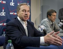 Washngton Wizards president Ernie Grunfeld, left, with coach Randy Wittman speaks to reporters during a news conference in Washington, Tuesday, Jan. 24, 2012. Wittman replaces Flip Saunders who was fired as coach of the Wizards on Tuesday. (AP Photo/Manuel Balce Ceneta)