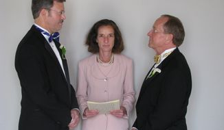 FILE - In this photo released by the Episcopal  Dioceses of New Hampshire, Mark Andrew, left, and Bishop V. Gene Robinson are shown during their private civil union ceremony performed by Ronna Wise in Concord, N.H., in this Saturday June 7, 2008 file photo. Robinson, the first openly gay Episcopal bishop, announced Saturday May 3, 2014 he is getting divorced from Andrew. (AP Photo/Episcopal  Dioceses of New Hampshire, File)