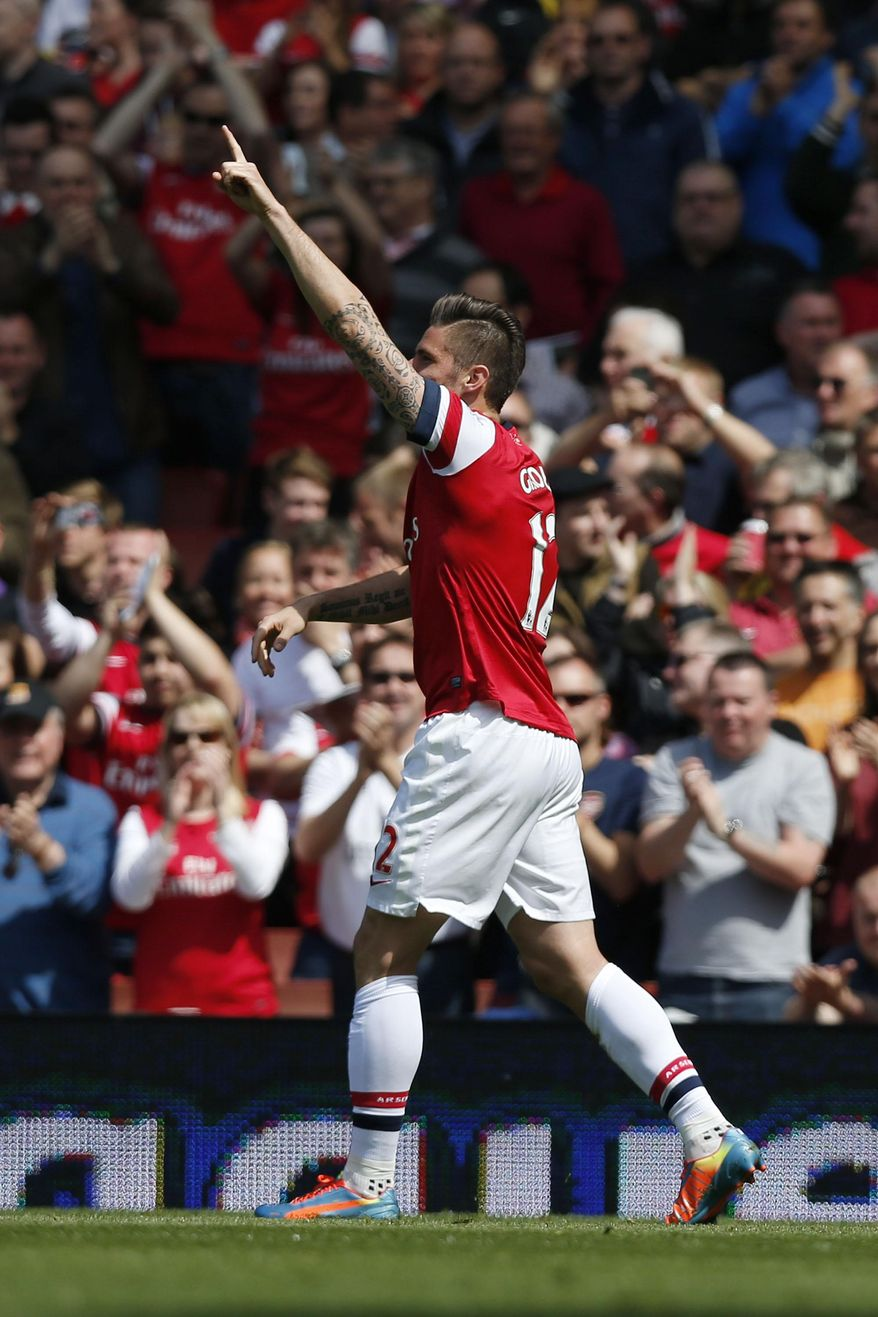 Arsenal's Olivier Giroud celebrates his goal against West Bromwich Albion during their English Premier League soccer match at Emirates Stadium in London, Sunday, May 4, 2014. (AP Photo/Sang Tan)