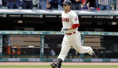 Cleveland Indians' George Kottaras runs home after a solo home run in the fourth inning of a baseball game against the Chicago White Sox, Sunday, May 4, 2014, in Cleveland. The home run was Kottaras' second of the game. (AP Photo/Mark Duncan)