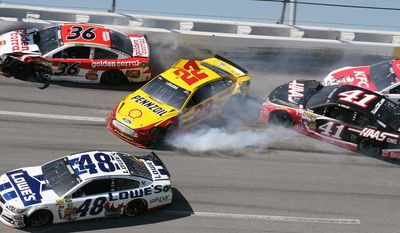 Joey Logano (22) collides with Reed Sorenson (36) as Kurt Busch (41) and David Ragan (34) and Jimmie Johnson (48) move through Turn 4 during the NASCAR Aaron's 499 Sprint Cup series auto race at Talladega Superspeedway, Sunday, May 4, 2014, in Talladega, Ala. (AP Photo/Dale Davis)