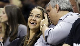 FILE - In this April 30, 2014, file photo, San Antonio Stars' Becky Hammon walks off the court following Game 5 of the opening-round NBA basketball playoff series between the San Antonio Spurs and the Dallas Mavericks in San Antonio. Spurs coach Gregg Popovich believes Hammon and other women can cross over and coach men, even in the NBA. (AP Photo/Eric Gay, File)