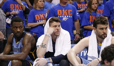 Memphis Grizzlies guard Tony Allen, left, forward Mike Miller, center, and center Marc Gasol, right, watch from the bench late in the fourth quarter of Game 7 of an opening-round NBA basketball playoff series against the Oklahoma City Thunder in Oklahoma City, Saturday, May 3, 2014. Oklahoma City won 120-109. Gasol  led Memphis with 24 points. (AP Photo/Sue Ogrocki)