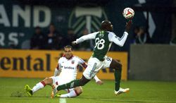 """Mamadou """"Futty"""" Danso of the Portland Timbers tries to collect the ball against DC United in action on Saturday. May 3, 2014 at Providence Park in Portland. (AP Photo/The Oregonian, Jamie Francis"""
