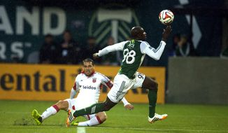 "Mamadou ""Futty"" Danso of the Portland Timbers tries to collect the ball against DC United in action on Saturday. May 3, 2014 at Providence Park in Portland. (AP Photo/The Oregonian, Jamie Francis"