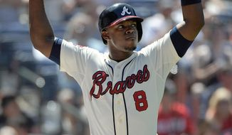 Atlanta Braves' Justin Upton reacts after he strikes out against the San Francisco Giants with a runner in scoring position during the sixth inning of a baseball game Sunday, May 4, 2014, in Atlanta. (AP Photo/David Tulis)