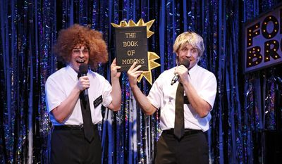 "This image released by Glenna Freedman Public Relations shows Marcus Stevens, left, and Scott Richard Foster parodying the musical ""The Book of Mormons,"" in Gerard Alessandrini's ""Forbidden Broadway Comes Out Swinging."" (AP Photo/ Glenna Freedman Public Relations, Carol Rosegg)"