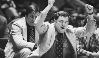 FILE - In this March 22, 1975 file photo, Providence coach Dave Gavitt urges his team on to victory in a semifinal NIT NCAA college basketball game against St. John's at New York's Madison Square Garden. The Big Ten and Big East will begin a series of eight games in the first week of the 2015-16 season, and the multi-day event will be named for the late Dave Gavitt. The original series, announced Monday, May 5, 2014,  is for eight years. (AP Photo/Suzanne Vlamis, File)