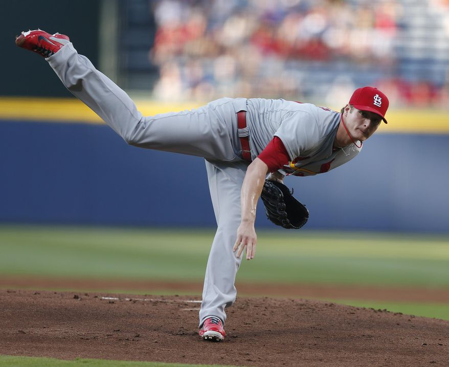 St. Louis Cardinals starting pitcher Shelby Miller (40) works against the Atlanta Braves in the first inning of a baseball game Monday, May 5, 2014 in Atlanta.  (AP Photo/John Bazemore)
