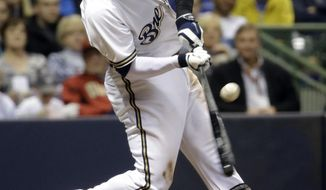 Milwaukee Brewers' Carlos Gomez hits a two-run single during the sixth inning of a baseball game against the Arizona Diamondbacks Monday, May 5, 2014, in Milwaukee. (AP Photo/Morry Gash)