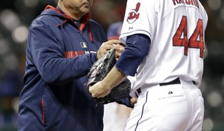 Cleveland Indians manager Terry Francona, center, takes relief pitcher John Axford, right, out of a baseball game against the Minnesota Twins in the 10th inning Monday, May 5, 2014, in Cleveland. Axford gave up a solo home run to the Twins' Eduardo Escobar and the Indians lost 1-0. (AP Photo/Mark Duncan)