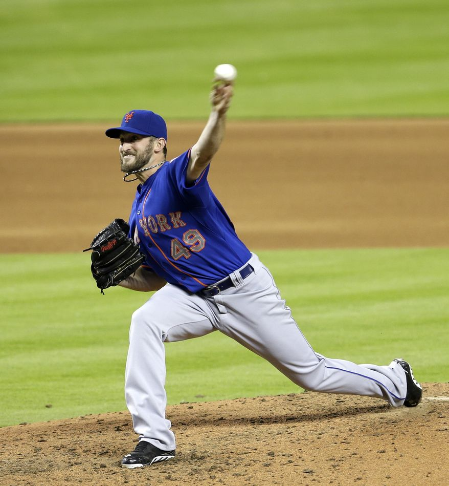 New York Mets' Jonathon Niese pitches against the Miami Marlins during the fourth inning of a baseball game in Miami, Monday, May 5, 2014. (AP Photo/Alan Diaz)