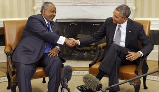 President Barack Obama, right, shakes hands with President Ismail Omar Guelleh of Djibouti, left, during a press availability before their bilateral meeting in the Oval Office of the White House in Washington, Monday, May 5, 2014. (AP Photo/Susan Walsh)