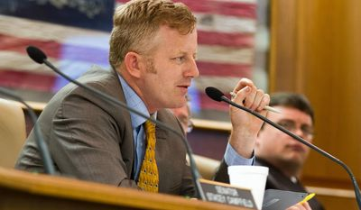 FILE - In this May 16, 2013, file photo, Republican state Sen. Stacey Campfield of Knoxville speaks at a Senate subcommittee hearing in Nashville, Tenn. Campfield was criticized by leaders of both the Republican and Democratic parties in Tennessee on Monday, May 5, 2014, for writing a blog post likening the insurance requirement under President Barack Obama's health care law to the forced deportation of Jews during the Holocaust. (AP Photo/Erik Schelzig, File)