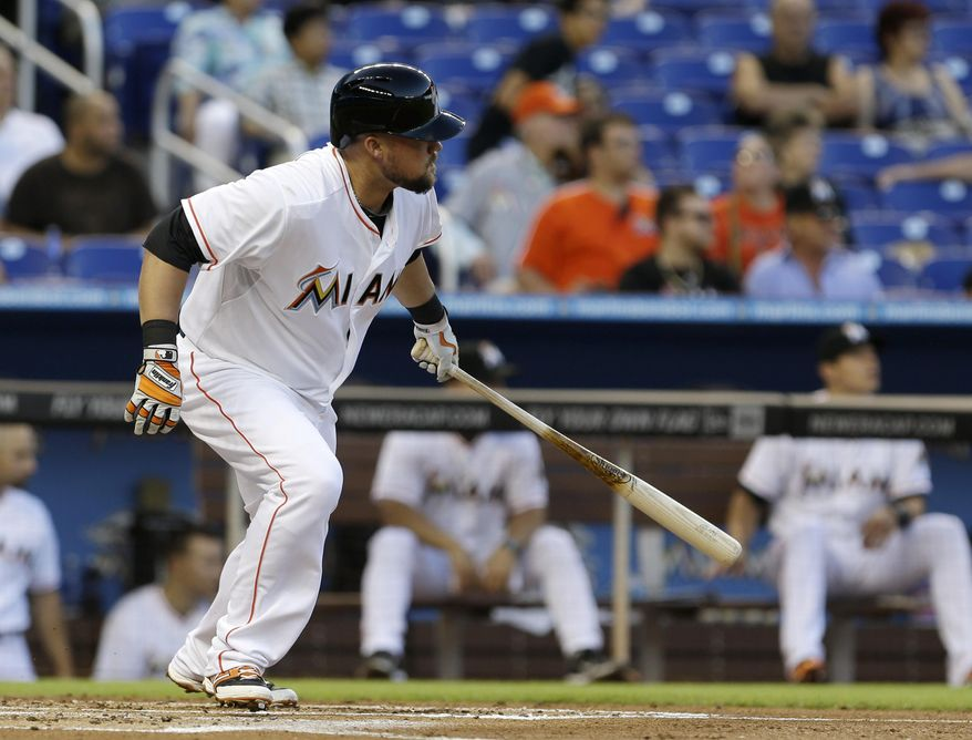 Miami Marlins' Casey McGehee prepares to head to first base after hitting a single against the New York Mets during the first inning of a baseball game in Miami, Monday, May 5, 2014. (AP Photo/Alan Diaz)