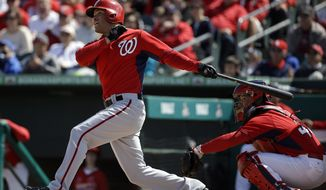 Washington Nationals' Scott Hairston plays in an exhibition spring training baseball game against the St. Louis Cardinals Wednesday, March 26, 2014, in Jupiter, Fla. (AP Photo/David Goldman)