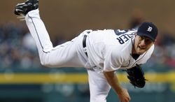 Detroit Tigers' pitcher Max Scherzer throws against the Houston Astros in the fifth inning of a baseball game in Detroit Monday, May 5, 2014. (AP Photo/Paul Sancya)