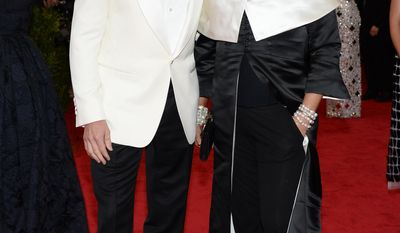 """Hugh Jackman, left, and Deborra-Lee Furness attend The Metropolitan Museum of Art's Costume Institute benefit gala celebrating """"Charles James: Beyond Fashion"""" on Monday, May 5, 2014, in New York. (Photo by Evan Agostini/Invision/AP)"""