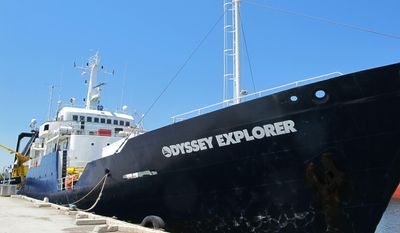 FILE - In this April 22, 2014, file photo, the Odyssey Explorer sits at a dock in North Charleston, S.C. The vessel left in April 2014, on an expedition to recover the remaining gold from the wreck of the S.S. Central America off the South Carolina coast. Odyssey Marine Exploration Inc. announced on Monday, May 5, 2014, that nearly 1,000 ounces of gold have been recovered from the wreck site. An earlier expedition a quarter-century ago recovered gold bars and coins worth about $50 million at that time. (AP Photo/Bruce Smith, File)