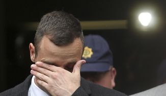 File: In this Monday, April 14, 2014 file photo, Oscar Pistorius leaves the high court in Pretoria, South Africa. The murder trial of  Pistorius is expected to enter a critical phase of testimony Monday as the defense attempts to overcome a faltering start and show how the disabled Olympic athlete fatally shot girlfriend Reeva Steenkamp by mistake because he was overwhelmed by a long-held fear of violent crime. (AP Photo/Themba Hadebe-File)