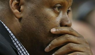 FILE - In this Feb. 16, 2014 file photo, Oregon State coach Craig Robinson watches during a game against Oregon, in Eugene, Ore. Oregon State fired Robinson, Monday, May 5, 2014,  after six seasons without making the NCAA tournament. (AP Photo/Chris Pietsch, File)