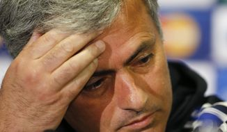 Chelsea's manager Jose Mourinho puts his hand to his forehead during a press conference at Stamford Bridge stadium in London, Tuesday, April 29, 2014. Chelsea will play in a Champions League semifinal second leg soccer match against Atletico Madrid on Wednesday. (AP Photo/Kirsty Wigglesworth)