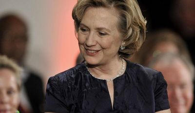 Hillary Rodham Clinton prepares to receive the Order of Lincoln Award from Illinois Gov. Pat Quinn at the Field Museum in Chicago, Saturday, May 3, 2014. (AP Photo/Paul Beaty)