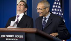 White House press secretary Jay Carney, left, and White House senior counselor John Podesta, right, laugh during the daily news briefing at the White House in Washington Monday, May 5, 2014. Podesta, who served as Chief of Staff under President Clinton, was answering a question about his returning to work for the White House. (AP Photo/Pablo Martinez Monsivais)