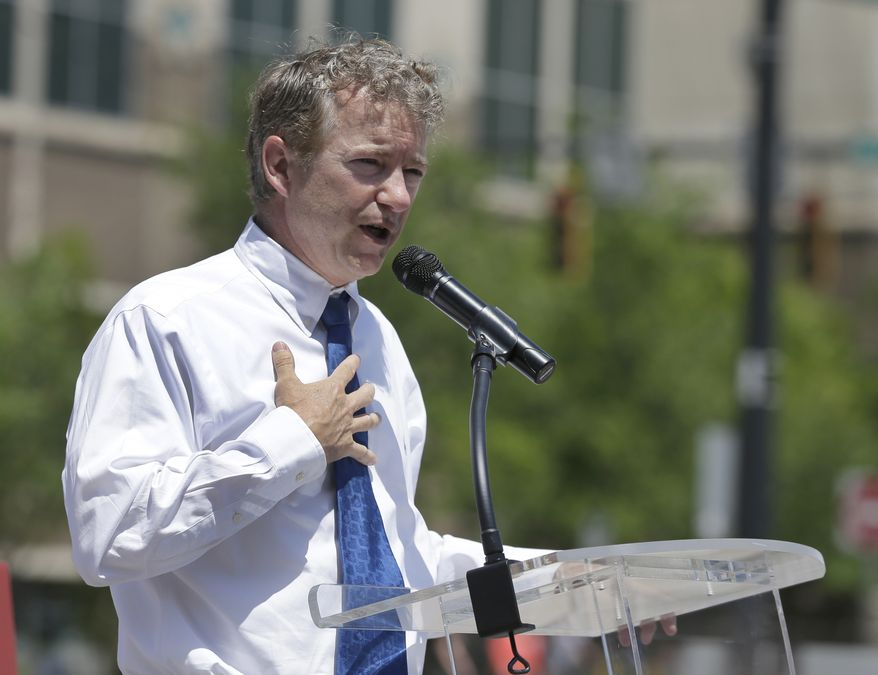 Sen Rand Paul (R-Ky) speaks at a campaign event for North Carolina Republican Senate hopeful Greg Brannon in Charlotte, N.C., Monday, May 5, 2014. The struggle for control of the Republican Party gets an early voter test in North Carolina, where GOP leaders Mitt Romney and Rand Paul push candidates competing for the right challenge Democratic Sen. Kay Hagan in the November midterm elections. (AP Photo/Chuck Burton)